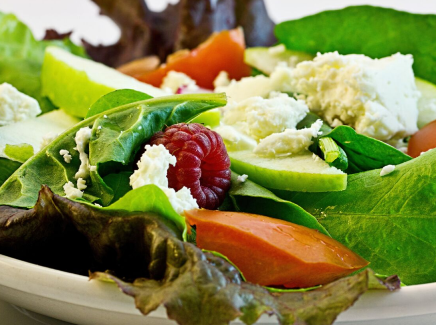 Nutrition: Healthy salad with romaine, raspberries, tomatoes and other healthy vegetables