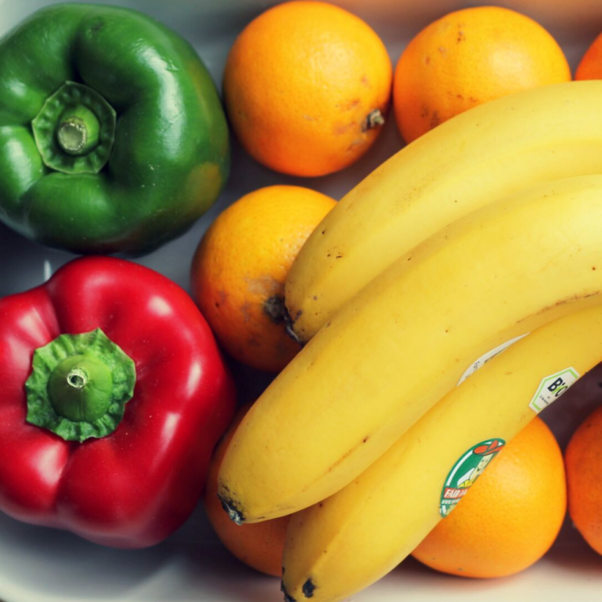 Healthy food: bananas, oranges and peppers